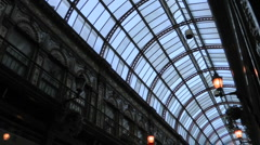 Pan down from glass roof Victorian elegance of Central Arcade 1902 Stock Footage