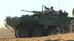 military, LAV3 armored fighting vehicle turret turns soldiers walk - stock footage