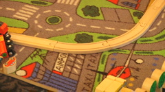 Wooden Toy train Tracks and Blocks on printed Rug Town Scene Stock Footage