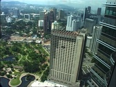 Stock Video Footage of View of Park and Downtown from the Petronas Towers, Kuala Lumpur GFSD