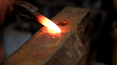 Blacksmith at work - stock footage