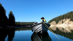 Fishing from a boat on a sunny day Stock Footage