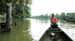 Stock Video Footage of Local canoes passing on the Kerala backwaters, nr Alleppey India