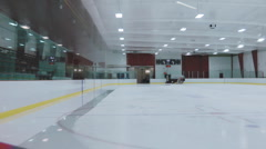 Canadian Indoor Hockey Arena Getting The Ice Cleaned With A Zamboni Stock Footage