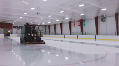 Ice Rink Arena Gets The Ice Cleaned With A Zamboni Machine Vehicle Stock Footage