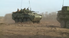 Military, LAV3 armoured fighting vehicle arrives behind 2nd LAV3 Stock Footage