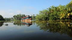 Passenger boat on the Kerala backwaters, nr Alleppey, Kerala, India - stock footage