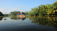 Passenger boat on the Kerala backwaters, nr Alleppey, Kerala, India Stock Footage