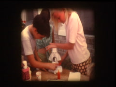 Kids make sno cones Frosty Sno-man Stock Footage