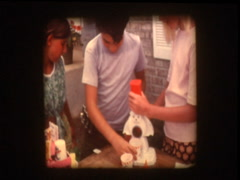 Kids use Frosty Sno-Man Snow Cone Machine 1970s HASBRO Stock Footage