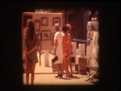 People at art show flea market in park Stock Footage