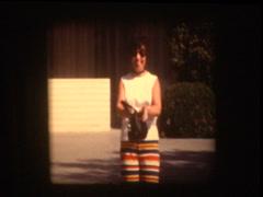 70s woman shows empty purse in Las Vegas hotel Stock Footage