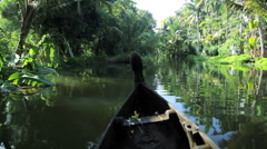 Traditional Local canoe passing along the backwaters, Kerala India - stock footage