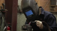 Stock Video Footage of Man Welding in Foundry