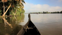 Water traffic on the Kerala backwaters nr Alleppey, Kerala, India - stock footage