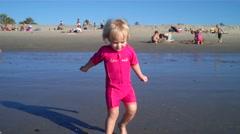 Cute girl playing in ocean Stock Footage