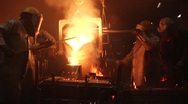 Foundry Pouring metal and sparks flying Stock Footage
