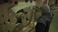Man Coats Mold Stock Footage