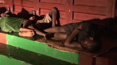 Street youth sleeping in Sierra Leone Stock Footage