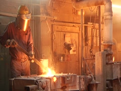 Man Working With Metal in Furnace Stock Footage