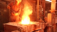 Stock Video Footage of Man Stirs Metal In Furnace/ CU Furnace