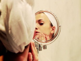 Stock Video Footage of Woman looking at herself in the mirror