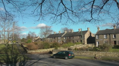 Rural Northumberland village, stone cottages, birds singing in stark trees. Stock Footage