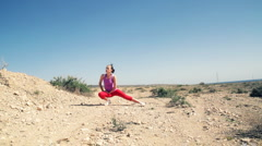 Woman doing stretching exercises for her legs outdoors Stock Footage