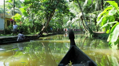 Traditional canoeing by local people on the backwaters, Kerala, Indi - stock footage