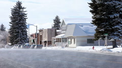 Winter melt small town street business P HD 8630 - stock footage