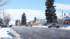 Winter small country town traffic P HD 8633 Stock Footage