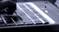 Typing - fast - blue light Stock Footage