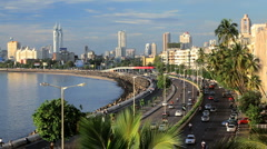 Beach and Marine drive with the Skyline of Mumbai City in the background, India Stock Footage