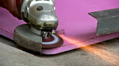 Shaping A Table Clasp Using A Metal Grinder - stock footage