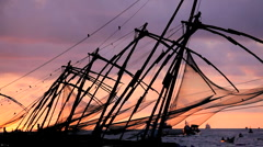 Chinese fishing nets at sun set  Fort Kochi, Cochin, Kerala India Stock Footage
