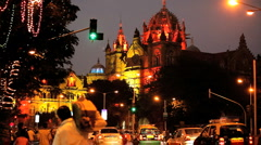 Busy Night time scene around the city CST Railway Station Mumbai, India - stock footage