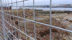 Old deserted ship yard through wire fence Stock Footage