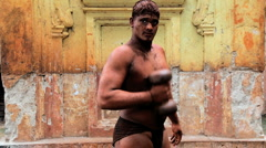Kushti wrestlers, ( ancient form of mud wrestling ), Kolhapur, India Stock Footage