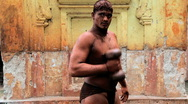Kushti wrestlers, ( ancient form of mud wrestling ), Kolhapur, India Stock Footage