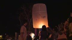 Thailand: Sky lanterns released into night sky Stock Footage