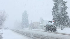 Snow blizzard traffic in small town P HD 8661 Stock Footage