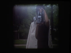 Mom and sons with Polaroid camera Stock Footage