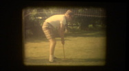Stock Video Footage of Man plays croquet in backyard