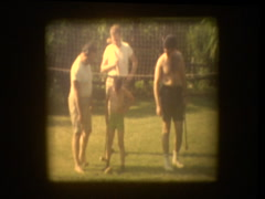 Family plays croquet in backyard Stock Footage