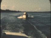 Stock Video Footage of 8mm Archive 1950's yacht overtaking another boat at high speed 8mm