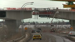West LRT Construction, elevated guideway crane  zoom back Stock Footage