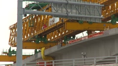 West LRT construction yellow crane low angle zoom Stock Footage