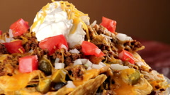 Stock Video Footage of Nachos rotating on plate