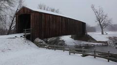 Covered Bridge snowing - stock footage