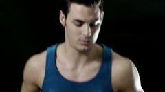 Man running on treadmill on black background Stock Footage